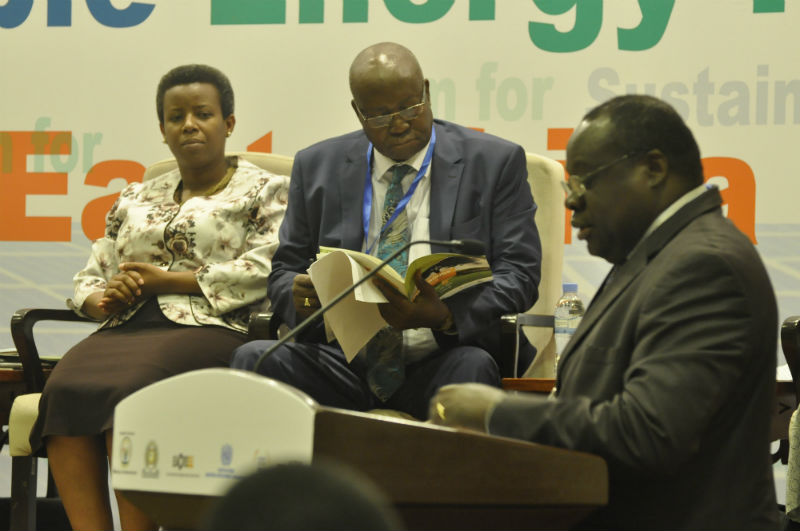 EAC Deputy Secretary General, in charge of Productive and Social Sectors, Hon. Christophe Bazivamo delivers his remarks during the opening of the Forum. Looking on are State Minister of Infrastructure Rwanda, Hon. Germaine Kamayirese and Minister of State for Energy Uganda, Hon. Simon D'Ujanga.
