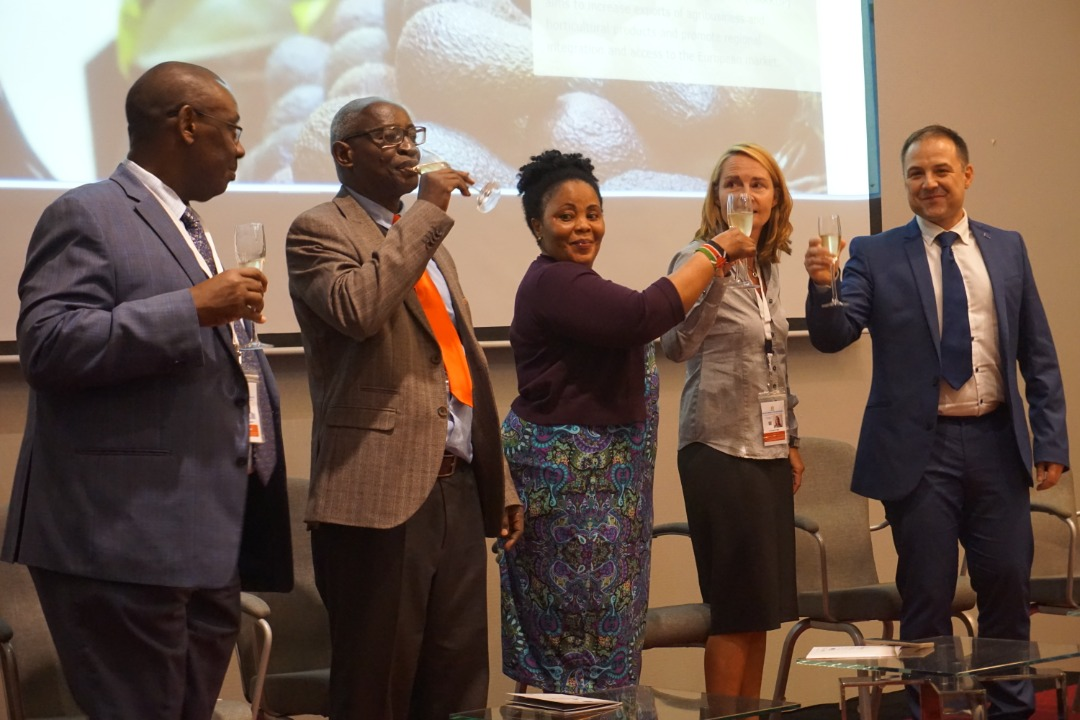 Kenya's EAC Affairs Principal Secretary, Dr. Margret Mwakima (centre), and her Burundian counterpart Amb. Jean Rigi (second left) toast to the launch of the EU-EAC MARKUP website. Also in the photo are (from left) the EAC Director General Customs and Trade, Mr. Kenneth Bagamuhunda, GIZ Programme Manager, Dr. Kirsten Focken and Mr. Jocelin Cornet, the Team Leader-Regional Cooperation at the EU Delegation in Tanzania.